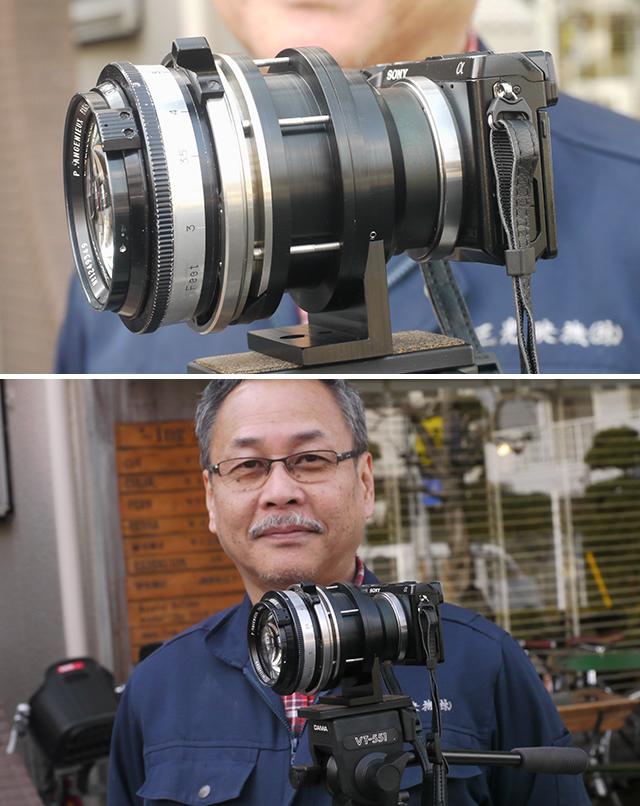 写真10 「ドヤ顔」の天野社長。完成したマウントアダプターを介して、アンジェニュー50mm F0.95をNEX-7に装着